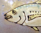 Subway tile with yellow jack fish