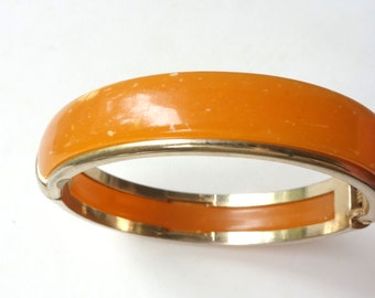 Vintage amber plastic bangle, made in Italy, possibly Lucite