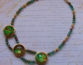 Green Fire-glass and acrylic necklace, green, blue, gold and orange, 19 inches