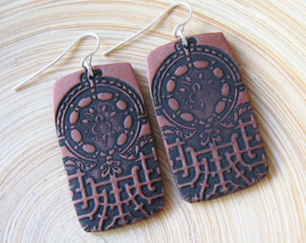 SALE Antiqued copper style earrings Asian crest design black, handmade jewery by theshagbag on Etsy