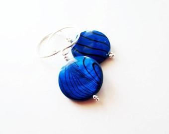 Cobalt blue shell earrings.  Cobalt blue earrings.  Round shell earrings.  Sterling silver earrings.
