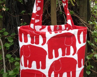 Red elephant oil cloth tote bag, lined, with snap