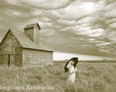 Approaching Storm, large original photograph of a boxer dog wearing vintage dress standing in prairie as storm approaches