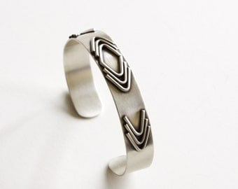 "Boho inspired geometric silver cuff with hand cut and formed elements, a modern and edgy bracelet design for any occasion - ""Arrowhead Cuff"""