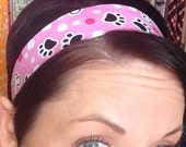 White Polka Dots, Bones, and Black Puppy Paws on Pink Stay Put Headband