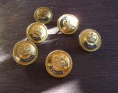 shiny gold buttons that say Canada on them, one button