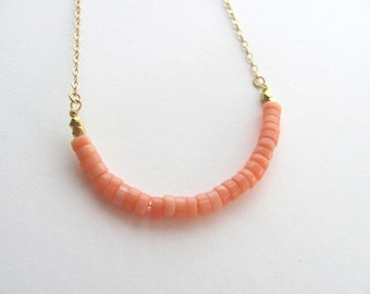 Pink coral minimalist necklace on delicate 14k gold plated chain with heishi beads, layering necklace