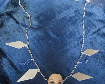 barbie doll head long necklace