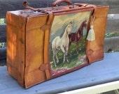 antique leather suitcase, with needlepoint horses