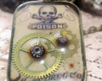 Vintage steampunk poison n Gears Necklace on bronze chain Skull crossbones