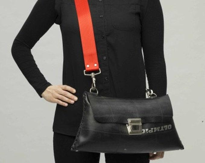 Upcycled innertube designer handbag with criss-cross hand-stitching. Waterproof Eco Fashion.