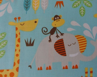 It's a Safari with a Giraffe, Lion, Elephant, Monkey in a jungle cotton fabric quilting & sewing