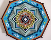 Golden Sun, a 16 inch, acrylic yarn mandala  IN STOCK
