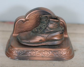 vintage steampunk baby bookend high buttoned shoe