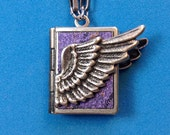 Winged Love Locket - purple and silver, holding 14 ways to tell someone you love them, from English to American Sign Language.
