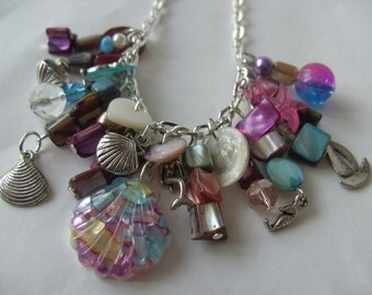 Shell, charm, necklace, purple, pink, teal, blue, sea life, mermaid, ocean, seahorse, by NewellsJewels on etsy