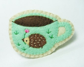 A hedgehog that loves coffee felt brooch - made to order