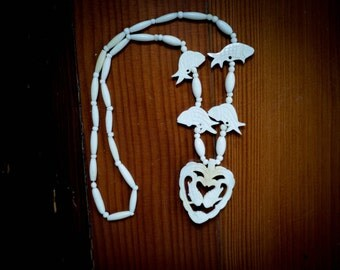 vintage white carved bone horoscope jewelry necklace pisces fish