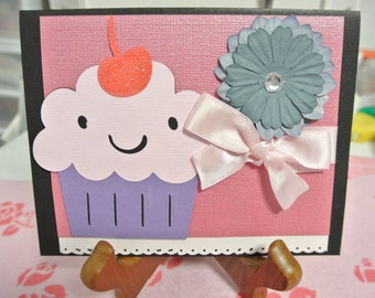 Big cupcake with flower greeting card