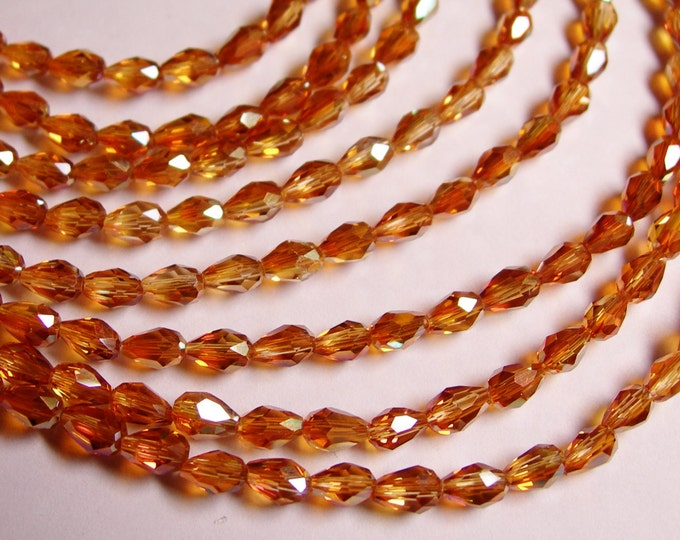 Faceted teardrop crystal beads - 100 pcs - 3mm x 5mm - sparkle tangerine - CLGD6