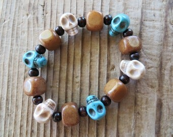 Ivory and Blue Howlite Turquoise Skulls and Jade Beaded Stretch Bracelet