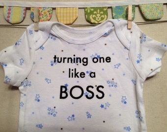 turning one like a boss --- blue patterned bodysuit, size 12 months