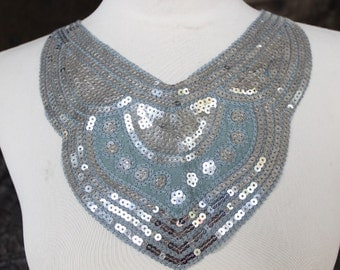 Grey color    embroidered  applique with silver color  sequence  1 pieces listing 14 inches wide at the neck 5 1/2 inches long at the center