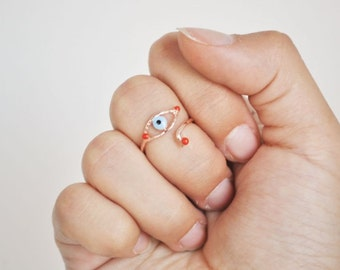 evil eye knuckle ring red enameled
