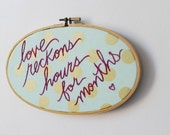 Love Quote Embroidery Hoop Art. Polka Dot Oval with Magenta Text. Hand Stitched. PRIM Collection by Merriweather Council