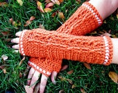 soft pumpkin-colored fingerless gloves with white trim and cable decoration