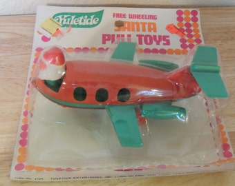 Santa in Plane Pull Toy in the Original Package