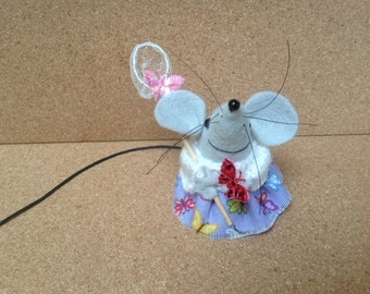 Angela, she is a very special mouse who  just loves to play with butterflies