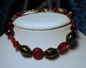 Simple red and gold bracelet.