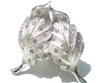 Pennino Vintage Clip On Earrings in Stylized Leaves with Tiny White Rhinestones on Rhodium Plating - Vintage Signed Costume Jewelry