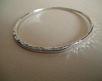 Hammered fine silver bangle bracelet, multi-faceted