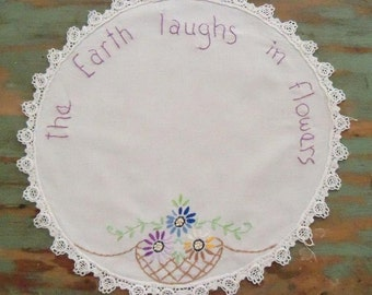 The earth laughs in flowers stitchery on vintage linen