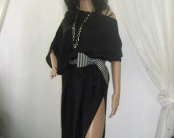 Unconventional and asymmetric silk tunic with a belt.