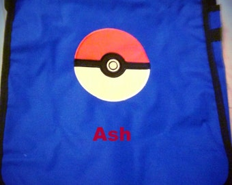 Sale item of the week!!  Pokemon pokeball design on personalized blue or red messenger bag