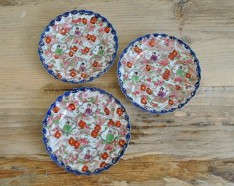 Vintage set of three of hand painted Oriental small side plates