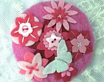 Pink and white felt brooch with embroidery and embellishment
