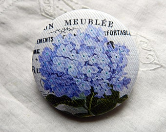 Fabric button drawing of blue hydrangea