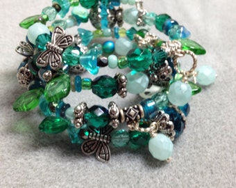 Shades of teal, aqua & green floral memory wire bracelet