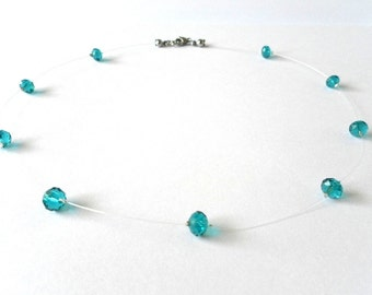 Teal turquoise sea blue crystal-like translucent floating illusion necklace, invisible durable line
