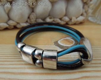 Leather bracelet turquoise brown. Hooked closure.