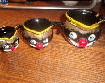 3 vintage black americana measuring cups