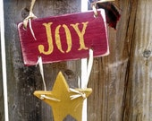 ONE little wooden ornament of Joy
