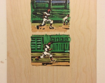 "Print on wooden panel, 12x9in. Linocut with watercolor added. ""Swing and Run."""