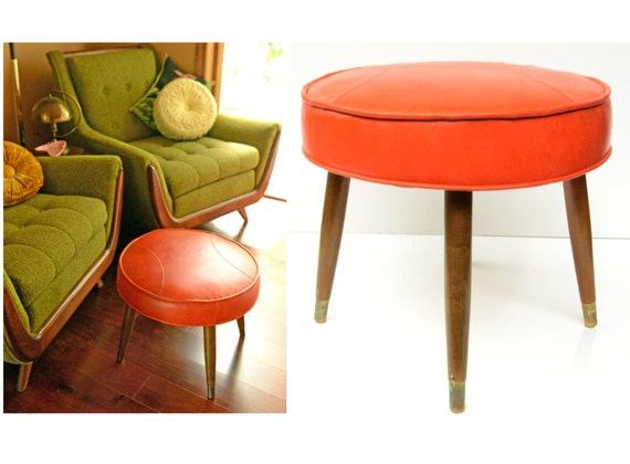 mid century ottoman,stool,vinyl,stool,orange,retro,atomic,round,side table,tapered wood legs,brass fittings,half moon stitching