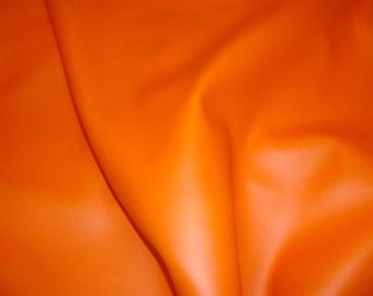 """Vinyl Faux leather Orange Soft Skin Faux vinyl upholstery/clothing pvc fabric by the yard 55"""" Wide"""
