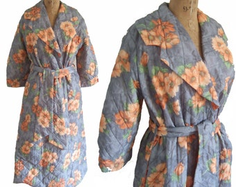 Vintage 1960s long quilted robe or dressing gown / bright orange floral print on grey and contrast lining / medium to large